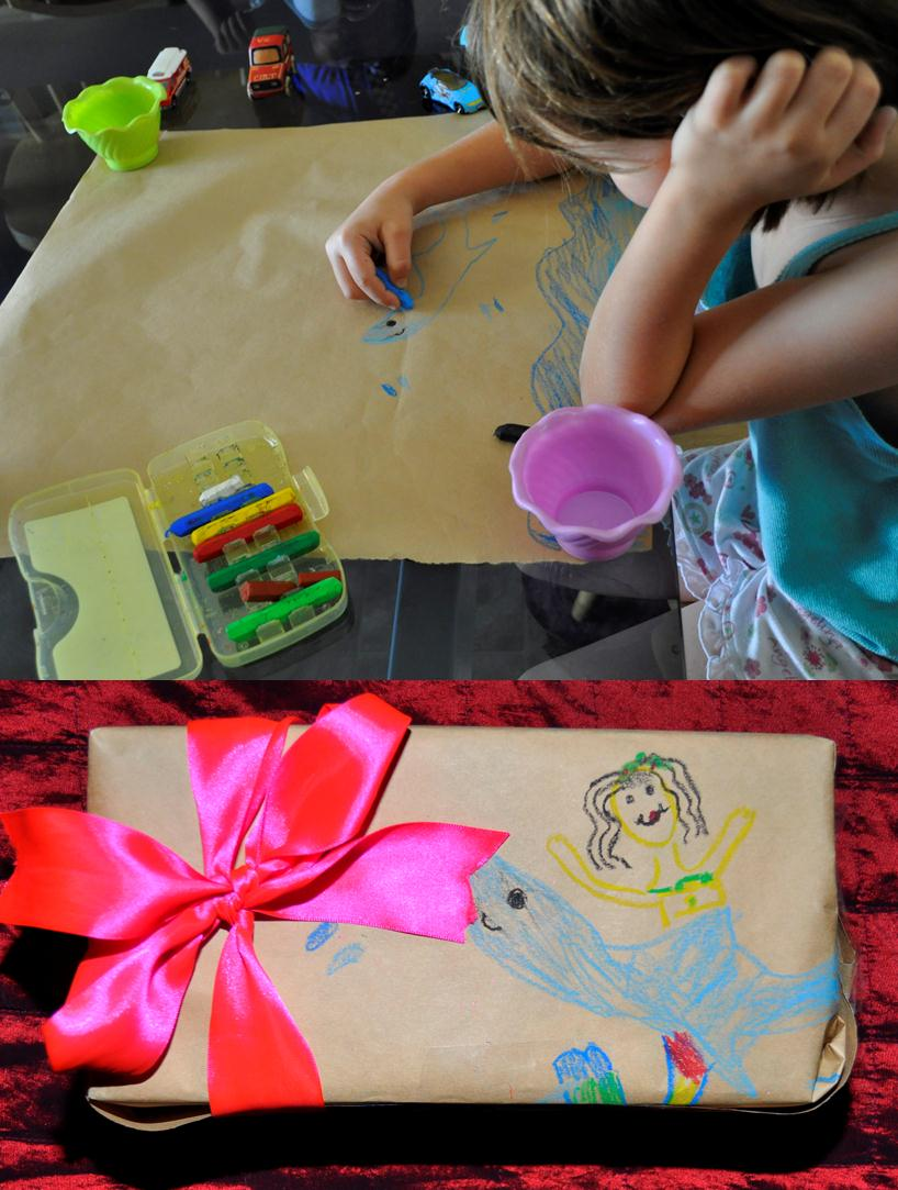 child drawing on brown Kraft paper wrappped present