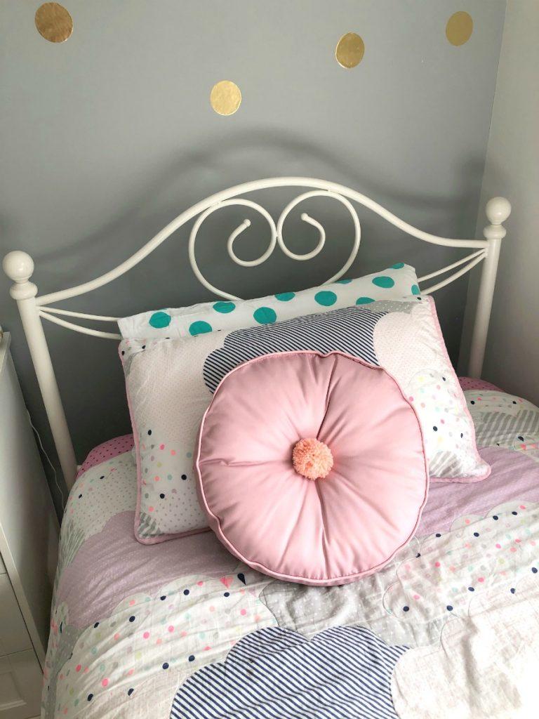 pink pom pom cushion