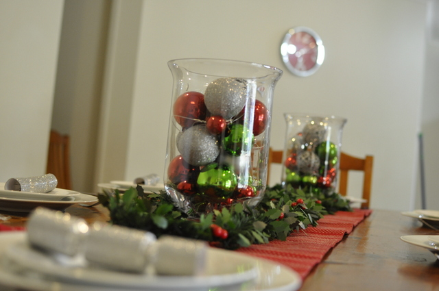 Christmas Table Ideas -- baubles in a vase with holly garland tinsel - beafunmum.com