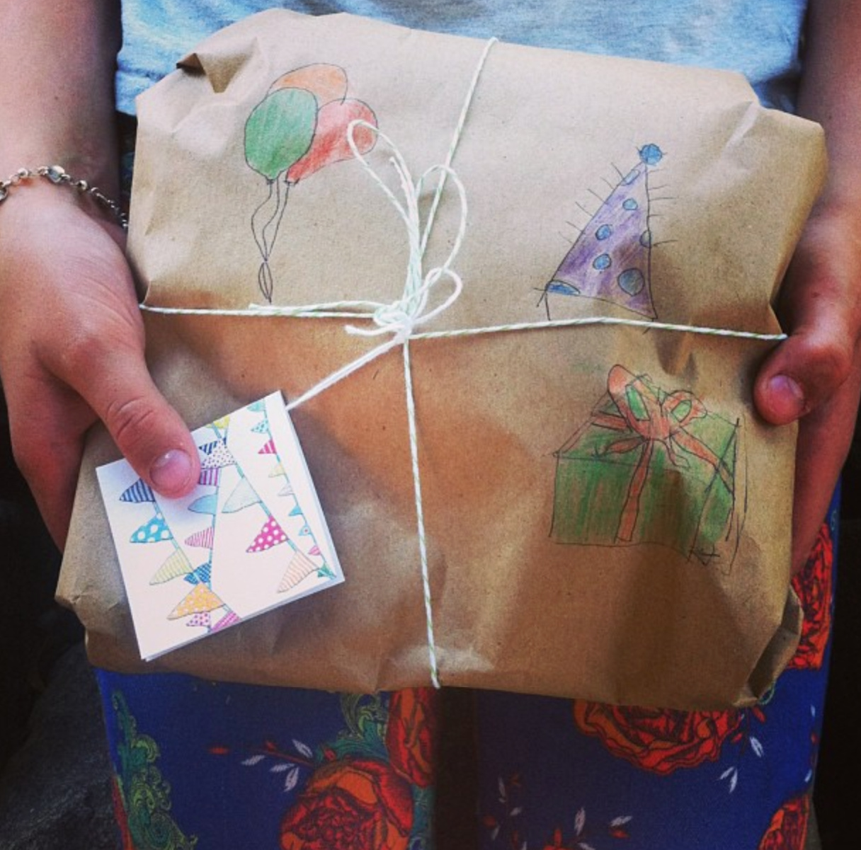 make your own wrapping paper - draw pictures on brown paper