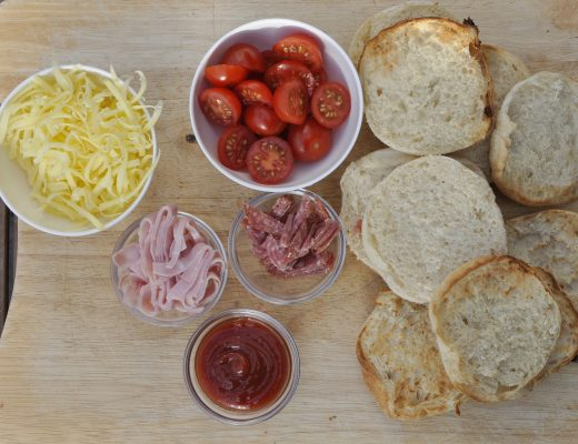 I used what I had in the fridge at the time which was tomato sauce, cherry tomato, salami and ham (which I cup up in shreds). I threw it all on to a board and the kids made their own.
