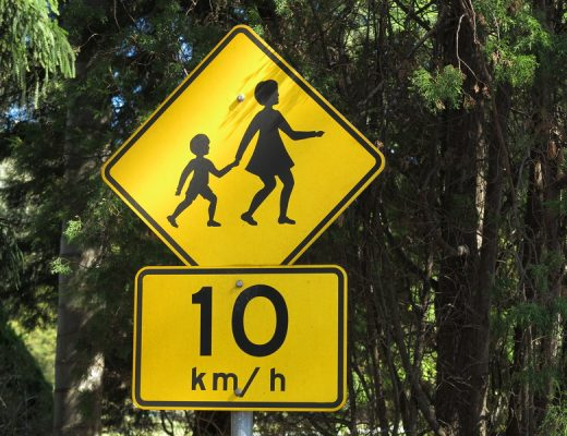 Mother crossing road sign