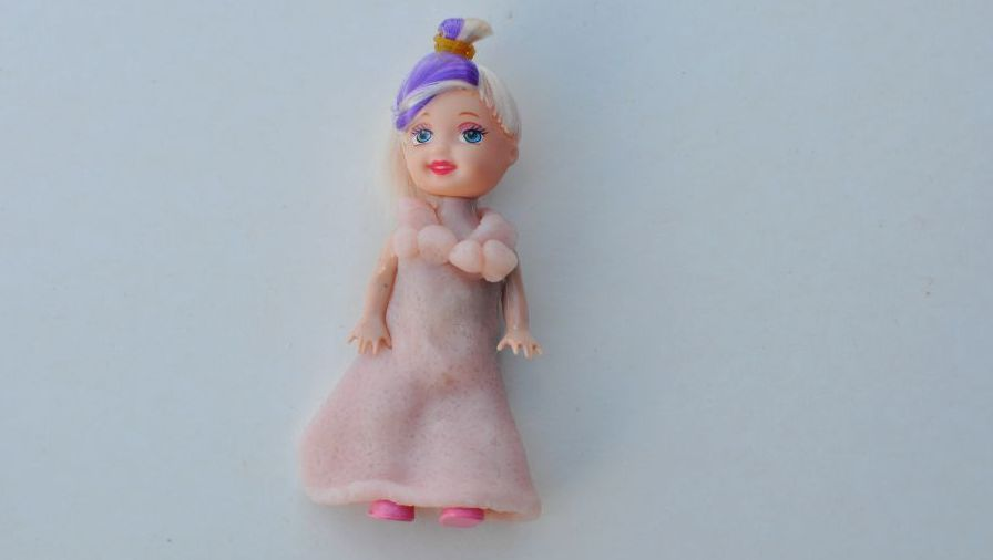 Use play dough to make dresses for dolls