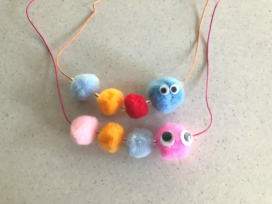 Caterpillar necklaces using pom poms