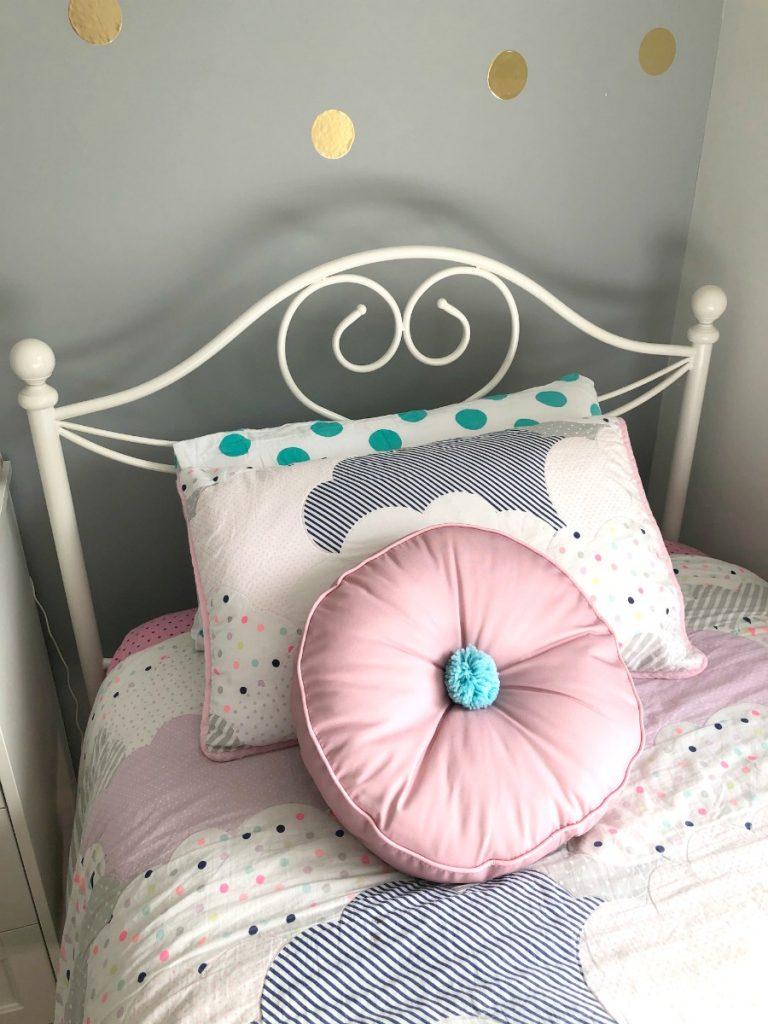 blue pom pom cushion