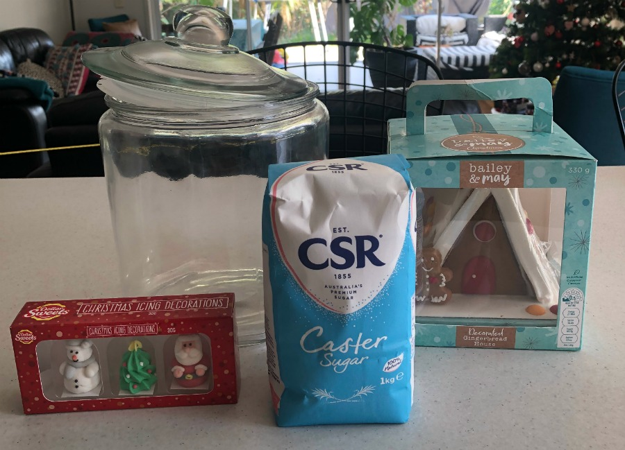 ingredients to make snow globe gingerbread house in a jar