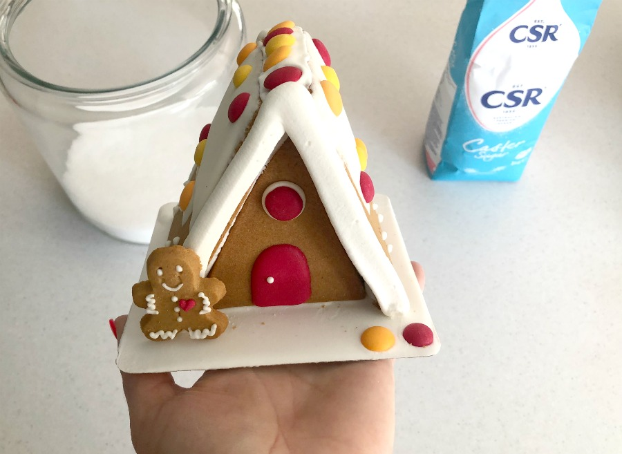 place gingerbread house in jar