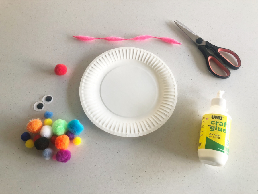 Materials to make a paper plate clown