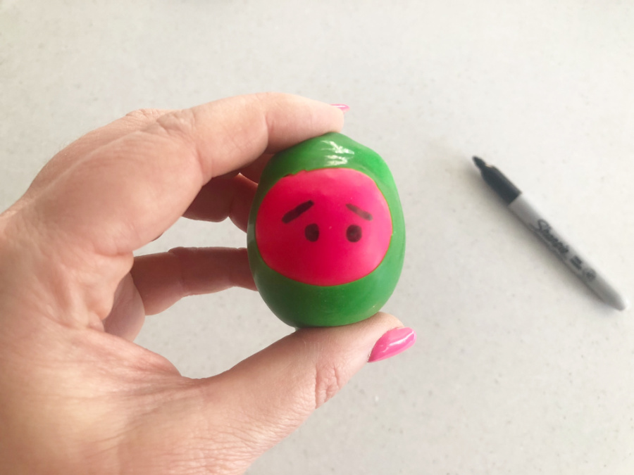 Draw eyes on ninja stress ball using sharpie pen